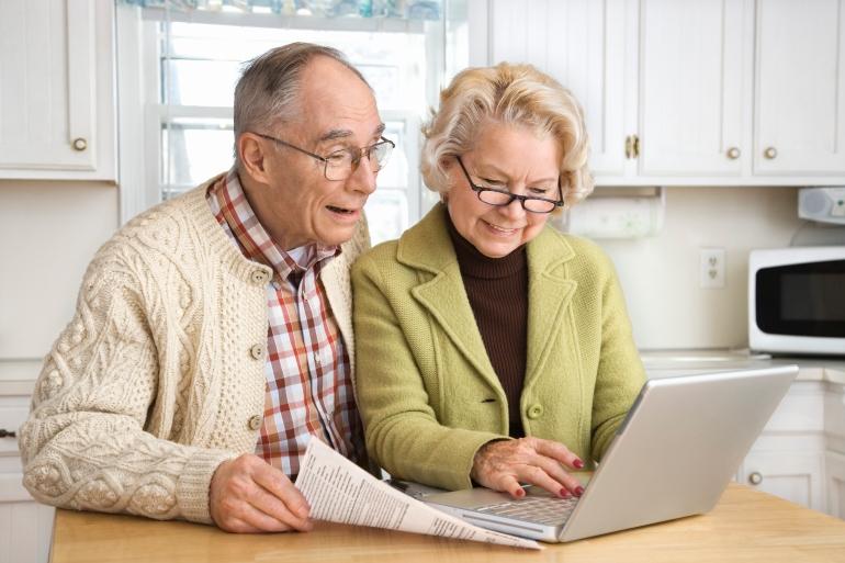 Senior couple working on laptop computer-76806758.jpg