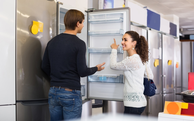 couple choosing new refrigerator-520324302.jpg