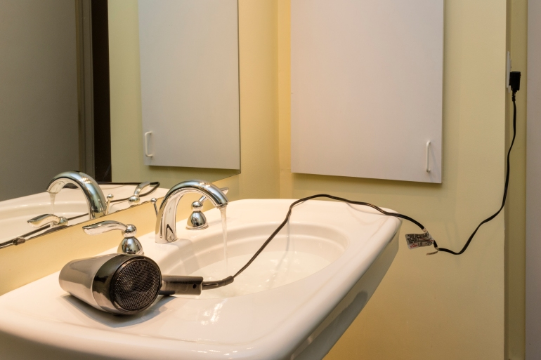 Electrocution risk from hair dryer near sink