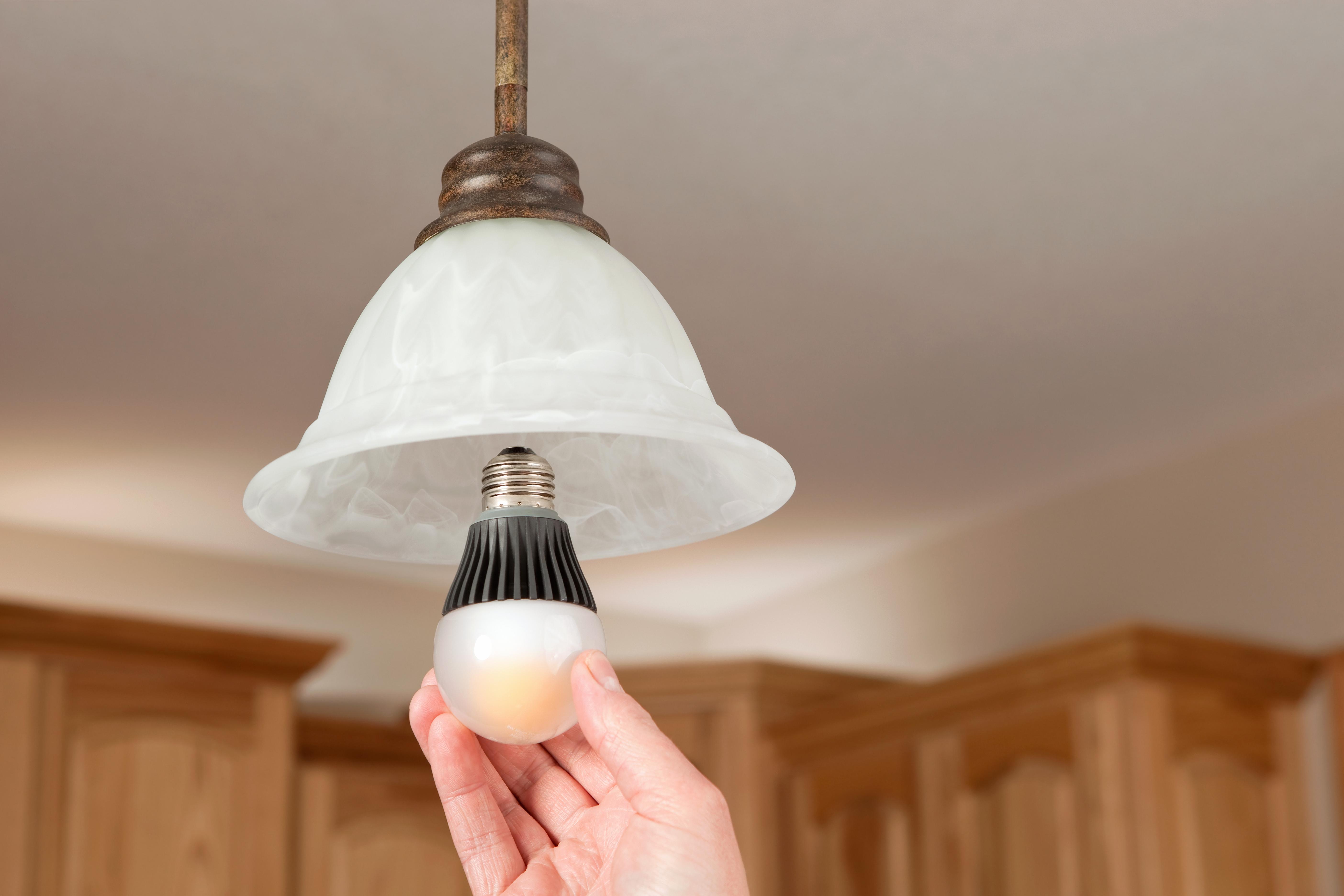 Hand Installing LED Light Bulb